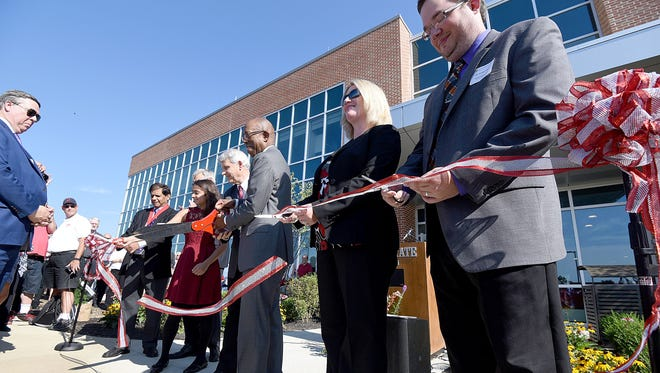 The Ohio State University President Dr. Michael Drake takes part with local dignitaries in the ribbon cutting for the new Science and Engineering Building on Tuesday.