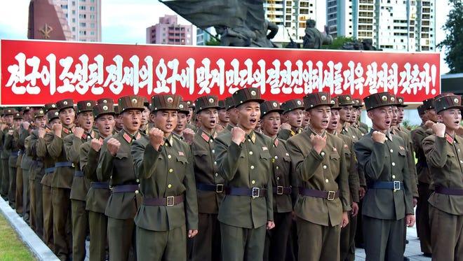 This picture taken on August 10, 2017 and released by North Korea's official Korean Central News Agency (KCNA) on August 11, 2017 shows service personnel of the Ministry of People's Armed Forces at a rally in support of North Korea's stance against the US, at the fatherland liberation war victory monument and education square in Pyongyang.
