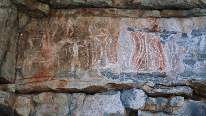 Apache Rock Art: Apache rock art containing both animal and human mythical horned figures. Note characteristic horse and rider and hour glass design.