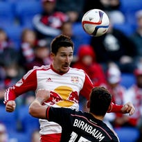 KANSAS CITY, KS - MARCH 08:  Sacha Kljestan #16 of New York Red Bulls competes for the ball as Amadou Dia #13 and Roger Espinoza #27 of Sporting KC look on during the game at Sporting Park on March 8, 2015 in Kansas City, Kansas.  (Photo by Jamie Squire/Getty Images)