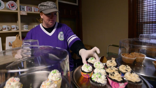 Kristin McCullough boxes up a gluten free cupcake Friday afternoon at Happy Goat Gluten Free Bakery & Bulk Foods in Lancaster.
