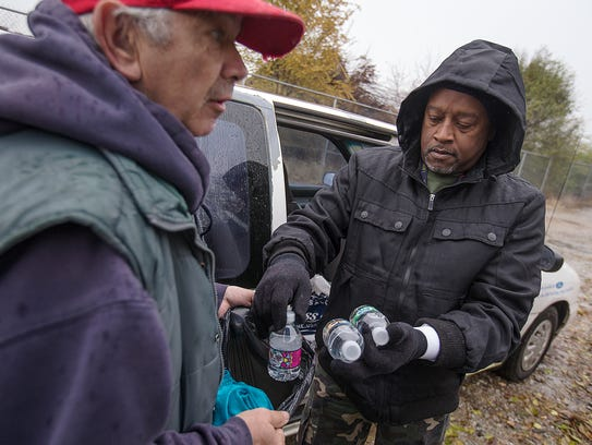 John Wheeler (left) receives water and food from Rodney