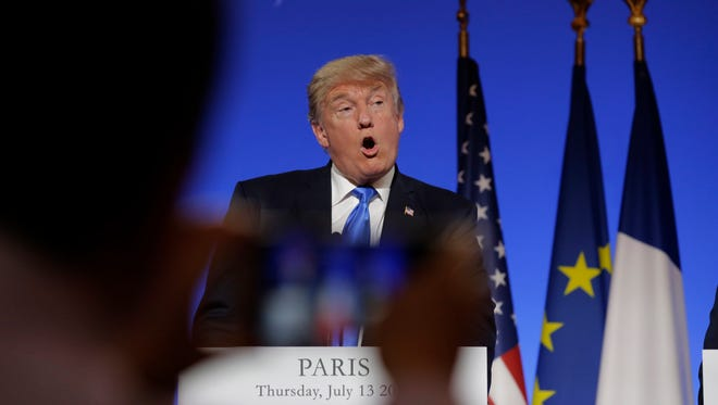 President Donald Trump speaks during a press conference with French President Emmanuel Macron at the Elysee Palace in Paris, Thursday, July 13, 2017. P
