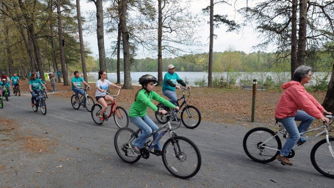Bikers cruise the trails at Trap Pond State Park during a rally Saturday May 3, 2014. Delaware tourism officials have been trying to develop an eco-tourism niche for a while but there are still obstacles in the way.