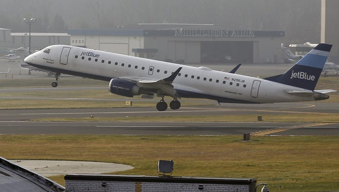 A JetBlue aircraft takes off at the Westchester County Airport on Dec. 11.