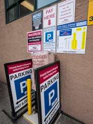 A Unified Parking Partners parking lot on Pine Street