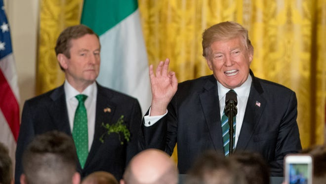President Trump, accompanied by Irish Prime Minister Enda Kenny, left, speaks during a St. Patrick's Day reception in the East Room of the White House on March 16, 2017.