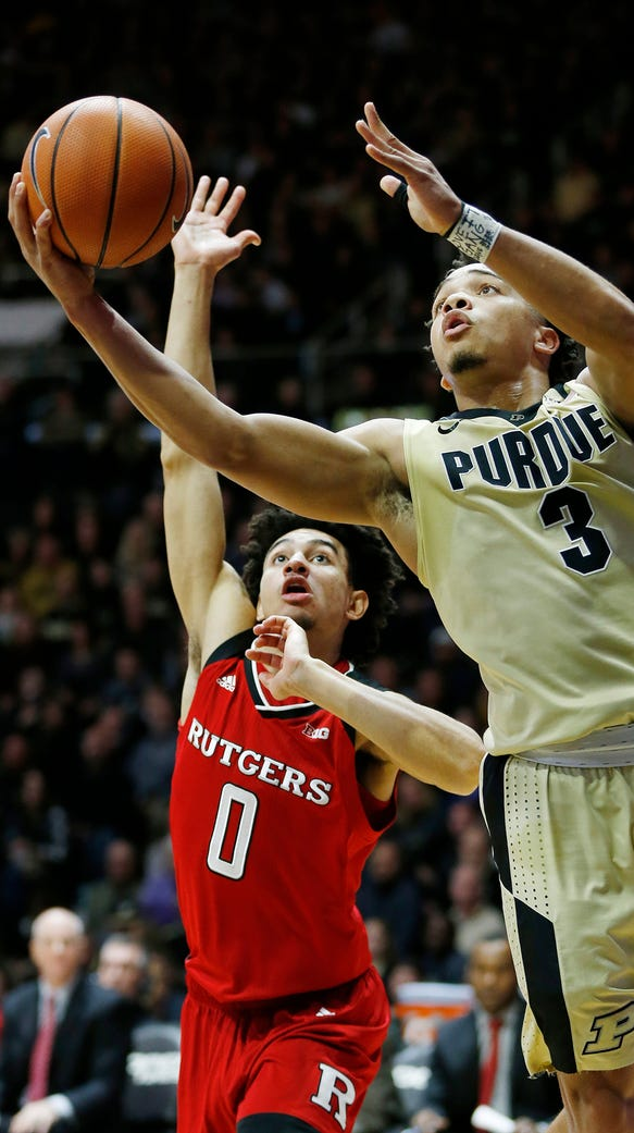 Carsen Edwards of Purdue gets around Geo Baker of Rutgers