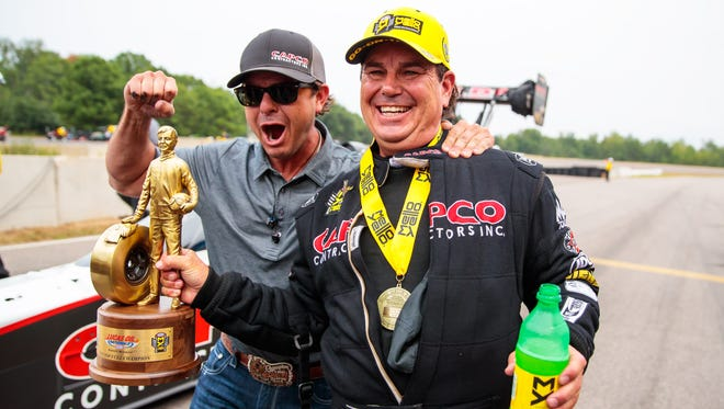 Billy Torrence, right, celebrates with son Steve Torrence after winning the Lucas Oil Nationals Sunday at Brainerd International Raceway.