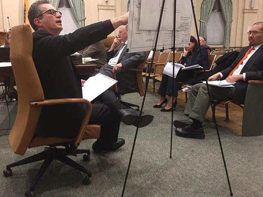 Robert Simon, an attorney representing a neighbor of a proposed synagogue on Rector Court in Bergenfield, questions the congregation's engineer at a hearing before the borough Zoning Board of Adjustment on Feb. 5, 2018.