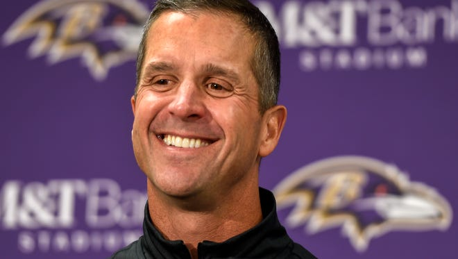 In this Sunday, Nov. 27, 2016, file photo, Baltimore Ravens head coach John Harbaugh answers a question during a post game press conference after defeating the Cincinnati Bengals 19-14, in Baltimore. With Baltimore leading Cincinnati by seven points, coach Harbaugh told his team to intentionally hold the Bengals to draw penalties while punter Sam Koch ran out of the back of the end zone. The strange but smart strategy ensured a victory for the Ravens rather than risking a fluke fumble or blocked kick.