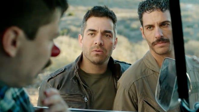 "Garza (Omar Chaparro, left) and Santos (Erick Elias) are old enemies in the action-comedy ""Compadres."""