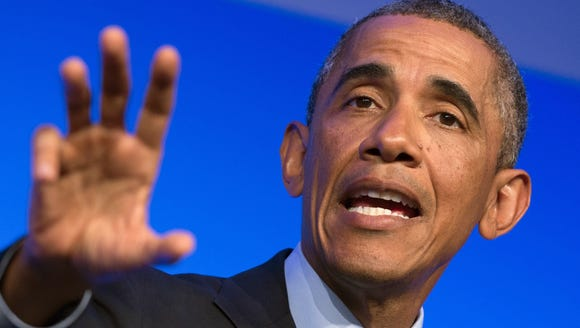 President Obama speaks at a press conference on the
