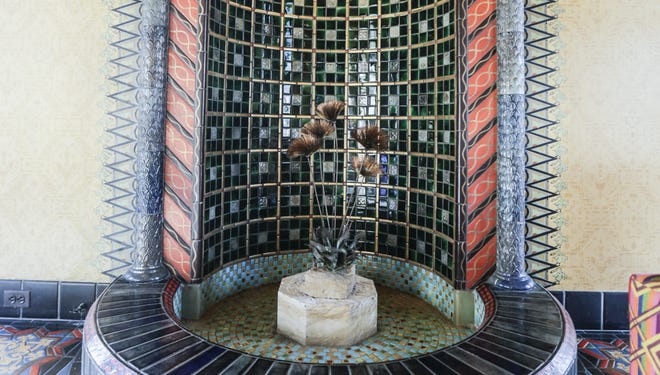 The sun room inside the Fisher mansion in Detroit's Palmer Woods neighborhood includes an intricately tiled fountain. The 15,116 square foot, 15-bedroom, 17-bathroom mansion sits on 2.06 acres and features room styles representing various periods from the 16th, 17th and 20th centuries.