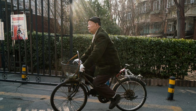 Han Zicheng, 85, rides his bicycle to a nearby market in Tianjin, China, in January.