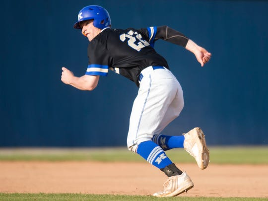 Karn's Ryder Green (22) runs to third during a high school baseball game between Karns and Campbell County Thursday, April 5, 2018. Karns defeated Campbell County.