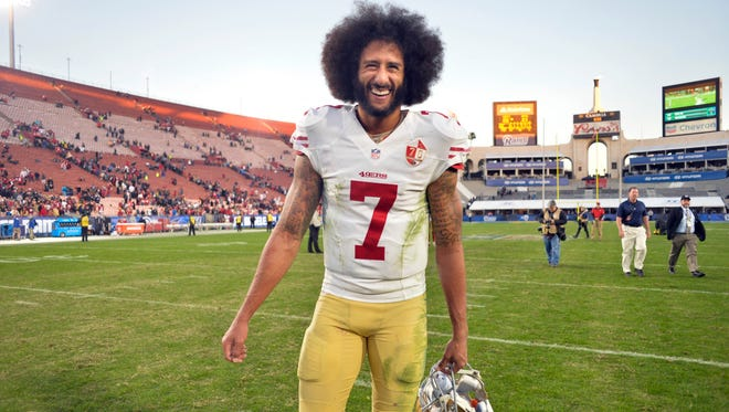 San Francisco 49ers quarterback Colin Kaepernick (7) smiles after a 22-21come-from-behind win over the Los Angeles Rams at Los Angeles Memorial Coliseum.