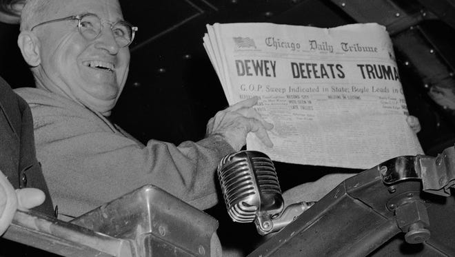 "U.S. President Harry S. Truman holds up an Election Day edition of the Chicago Daily Tribune, which, based on early results, mistakenly announced ""Dewey Defeats Truman"" on Nov. 4, 1948. The president told well-wishers at St. Louis' Union Station, ""That is one for the books!"""
