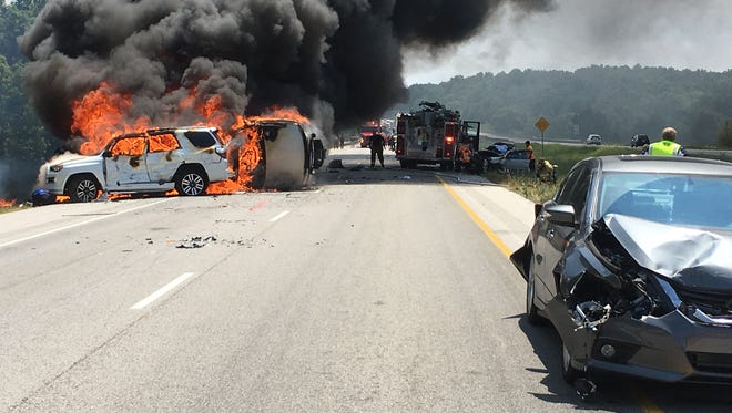 Fire erupts Aug. 4, 2017, minutes after a semi-truck plowed full speed into cars stopped for construction on Interstate 24 in southern Illinois, near its junction with I-57.