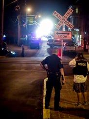 In this file photo, police investigate the scene where