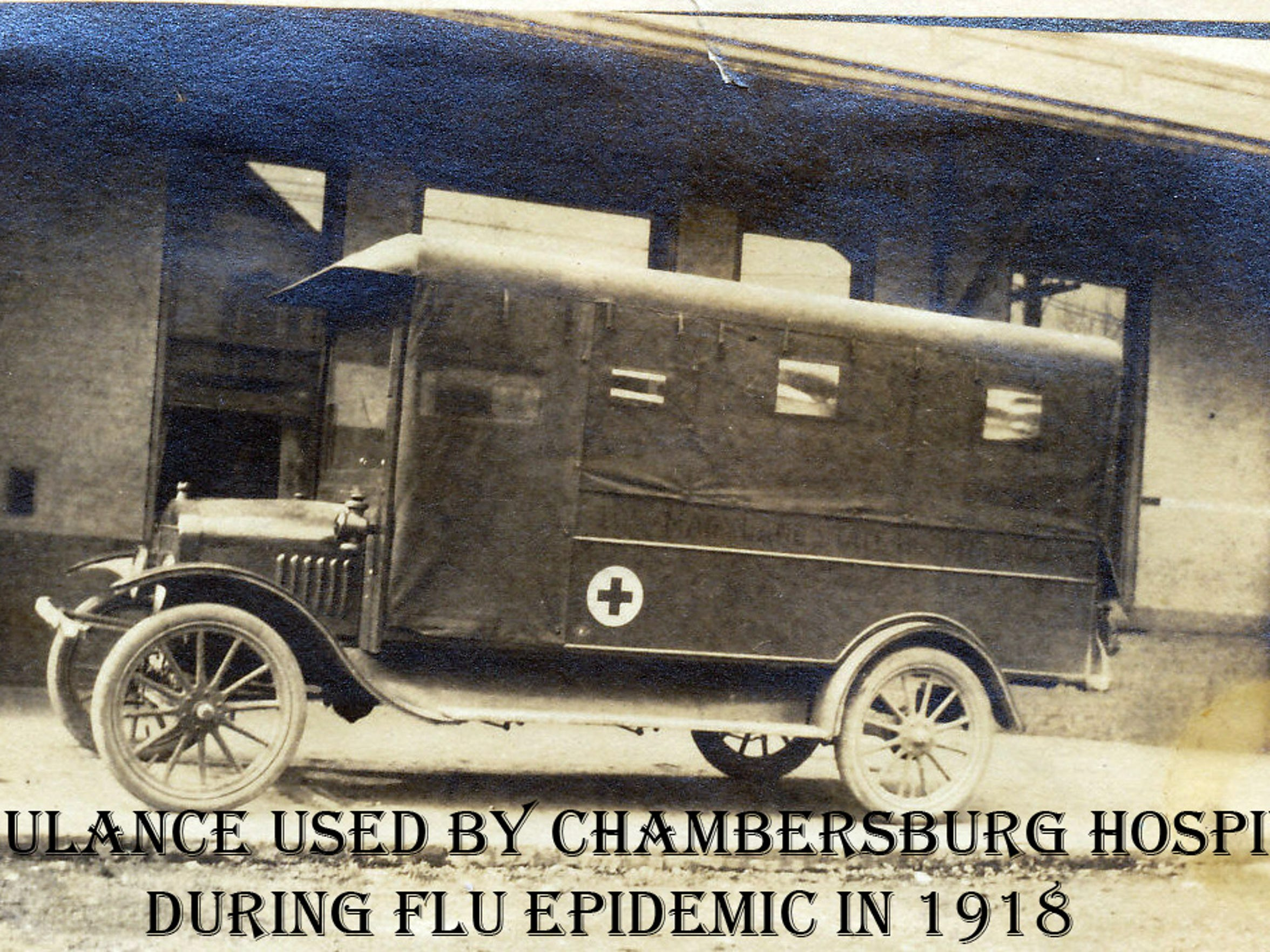 The ambulance used by Chambersburg Hospital during the 1918 flu epidemic is pictured at the corner of North Third and East King streets at the former Cumberland Valley R.R. Station.