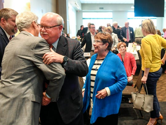 Fellow Rotary Club members congratulate local attorneys Brian and Barbara Williams after they were named the Rotary Club of Evansville's annual Civic Award winners for 2016 on Tuesday, April 18, 2017.