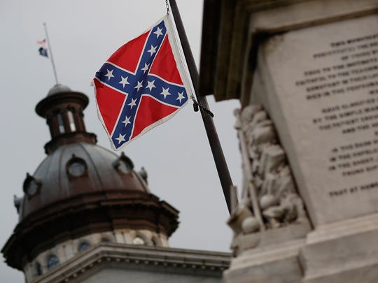 The Confederate flag flies on the Capitol grounds one day after then-South Carolina Gov. Nikki Haley announced on June 23, 2015, that she would call for the Confederate flag to be removed.