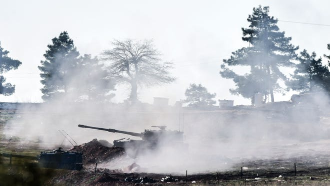Turkish army cannon shoots toward Syria in Kilis, in south-central Turkey, on Feb. 15, 2016.