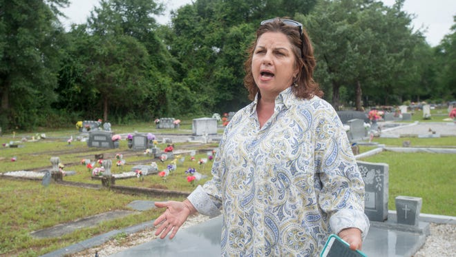 Pam Mitchell, chairman of the Milton Historic Cemetery board, talks about the cleanup effort in memory of longtime cemetery manger Bill Bledsoe on Thursday, June 1, 2017, at the cemetery. Bledsoe, who took charge of overseeing the cemetery after moving to the area in July 2000, passed away on Friday, May 26, 2017, at the age of 87.