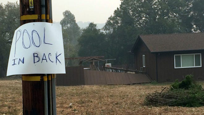 A home in the hills above Sonoma has a posted sign alerting people to an available pool if needed to shelter from wildfires on Friday.