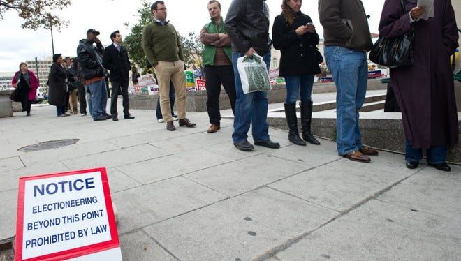 People line up to cast their ballots at an early-voting center in Washington on November 2, 2012. Early voting in Washington was extended after polls closed due to Superstorm Sandy.