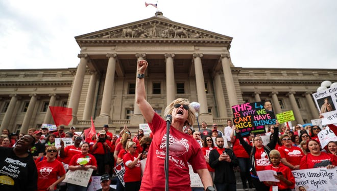 Teacher Robin Burr leads a chant during a protest and rally in Frankfort, Kentucky, in spring 2018. Teachers throughout Kentucky protested at the state capitol in March and April 2018.