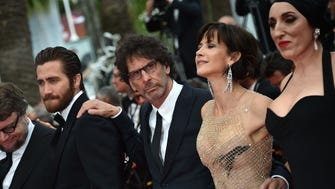 US director and President of the Cannes jury Joel Coen poses with jury members  Mexican director Guillermo del Toro, US actor Jake Gyllenhaal, French actress Sophie Marceau and Spanish actress Rossy de Palma.