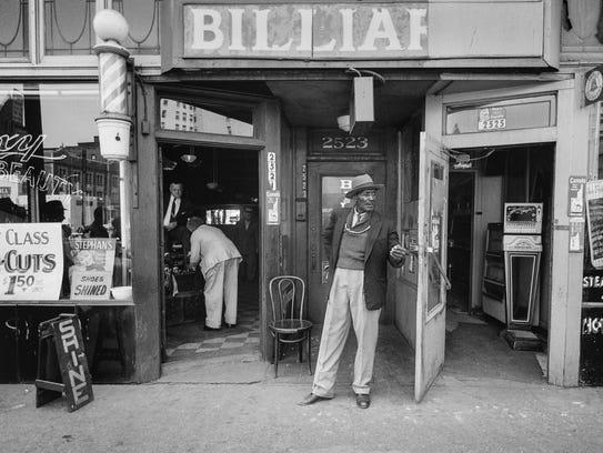 "Bill Rauhauser's ""Billiards/ Roxy Barber Shop"" is a"