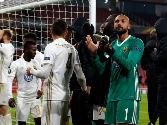 Ostersunds players applaud the fans after the Europa League Round of 32, second leg soccer match between Arsenal and Ostersunds FK at the Emirates Stadium in London, Thursday, Feb. 22, 2018. Ostersunds won the match 1-2 but lost on aggregate. (AP Photo/Alastair Grant)
