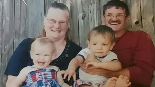 Barbara Butler (left) holding granddaugher Shylynne and Ron Niemi (right) holding grandson Sincere