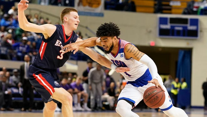Tennessee State's Delano Spencer drives against Belmont's Dylan Windler in Thursday night's game at Gentry Center.