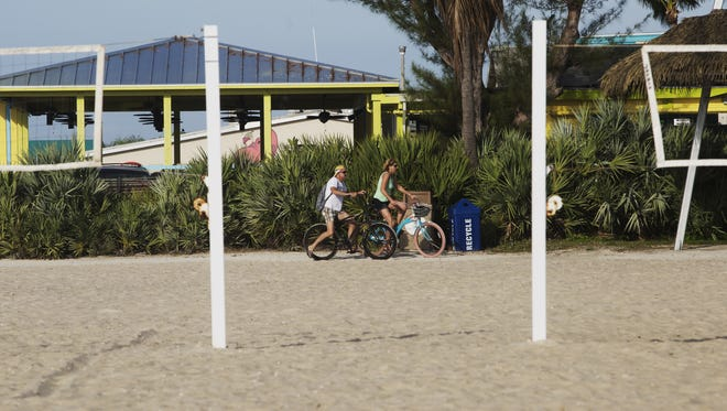 Bicyclists use the public access at Crescent Beach Park on Fort Myers Beach recently.  The park is owned and maintained by Lee County and is part of the Grand Resorts FMB development proposal.