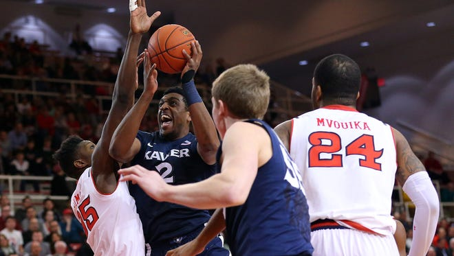 Xavier Musketeers forward James Farr (2) works to shoot over St. John's Red Storm center Yankuba Sima (35) during the first half at Carnesecca Arena.