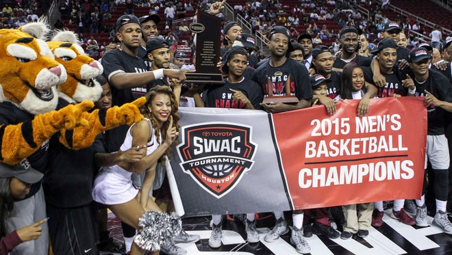 Members of the Texas Southern Tigers celebrate after winning the championship game of the SWAC Conference Tournament against the Southern University Jaguars at Toyota Center. The Tigers defeated the Jaguars 62-58. Mandatory Credit: Troy Taormina-USA TODAY Sports