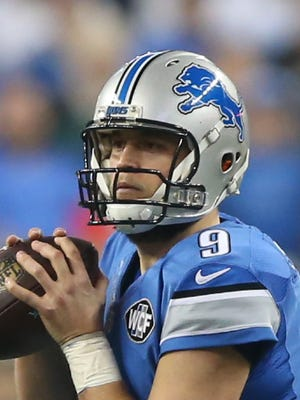 Detroit Lions Matthew Stafford calls a play against the San Francisco 49ers during second half action Sunday, December 27,2015 at Ford Field in Detroit Michigan.