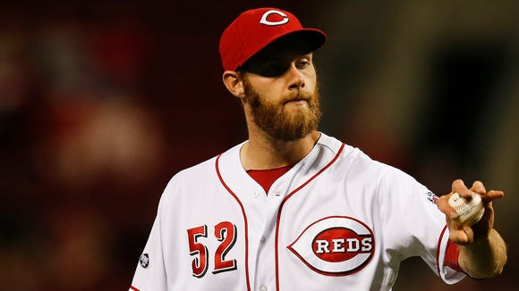 Reds reliever Tony Cingrani reacts after surrendering