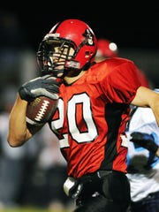 Pewaukee's Derek Watt brings a ball to the end zone during his high-school playing days.
