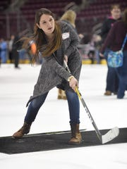 Samantha Burda practices shooting the puck during the Hershey Bears' annual Hockey In Heels event at the Giant Center on Wednesday, Jan. 11. The event provides interactive on and off the ice activities for female fans.