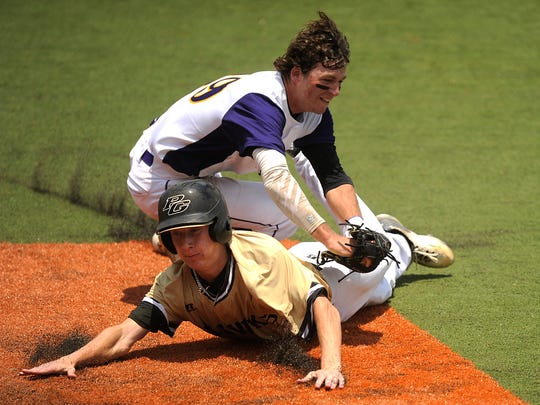 Wylie shortstop Zach Smith (39) tags out Texarkana Pleasant Grove baserunner Tanner Cole (20) in a run down during the top of the second inning of the Bulldogs' 7-5 win in the Class 4A state semifinal baseball game on Wednesday, June 8, 2016, at Disch-Falk Filed in Austin.