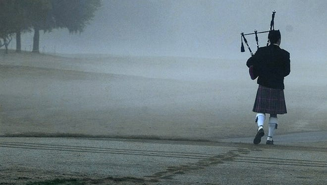 A bagpiper plays Going Home as he leaves a memorial service for Payne Stewart at the PGA Tour Championship in Houston on Oct. 28, 1999.