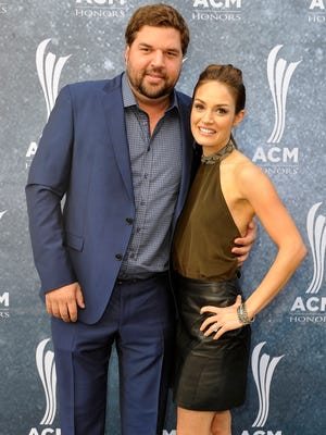 Dallas Davidson, left, and his wife, Natalia, arrive on the red carpet during the ACM Honors event at Ryman Auditorium in Nashville on Sept. 1, 2015.