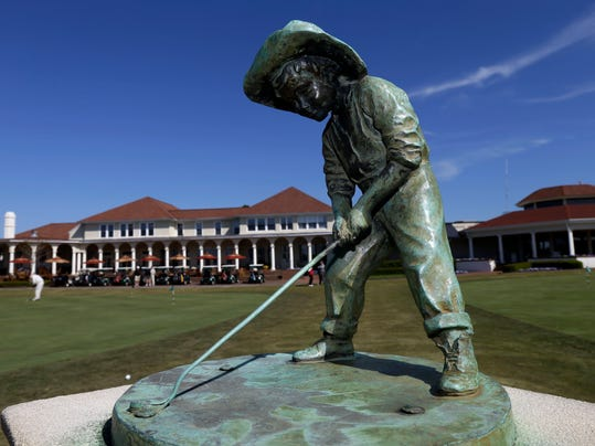 """The """"Putterboy"""" statue is shown at Pinehurst Resort & Country Club during media day for the upcoming back-to-back U.S. Open and U.S. Women's Open golf championships to be held this June in Pinehurst, N.C., Monday, April 21, 2014. (AP Photo/Gerry Broome)"""