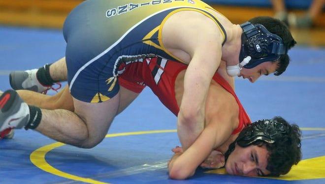 Garrett Semenetz of Mahopac defeated Matias Rivera of Fox Lane in a major decision in a 113 pound bout during a dual wrestling meet at Mahopac High School Dec. 17, 2015.