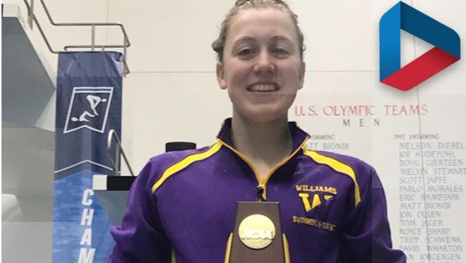 Molly Craig poses with her trophy after winning the NCAA Division III title in the 400 individual medley.